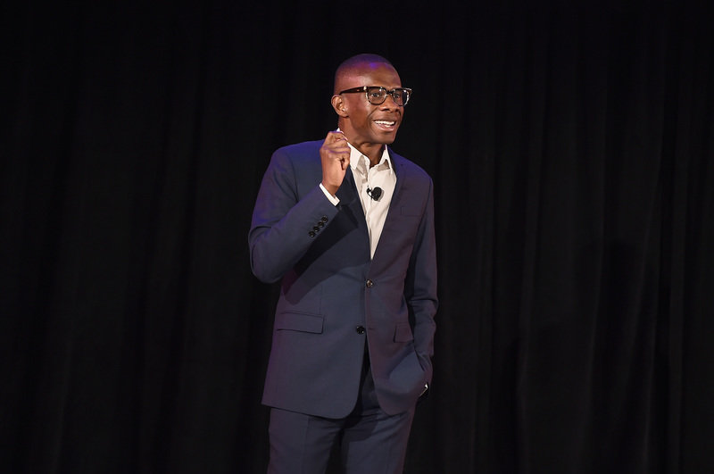 Spotify's Global Head of Creator Services Troy Carter introduces Spotify's new ad-supported mobile version at a news conference in New York.JPG