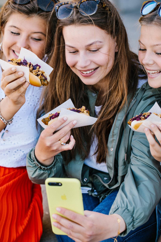 IKEA People eating veggie hot dog.jpg