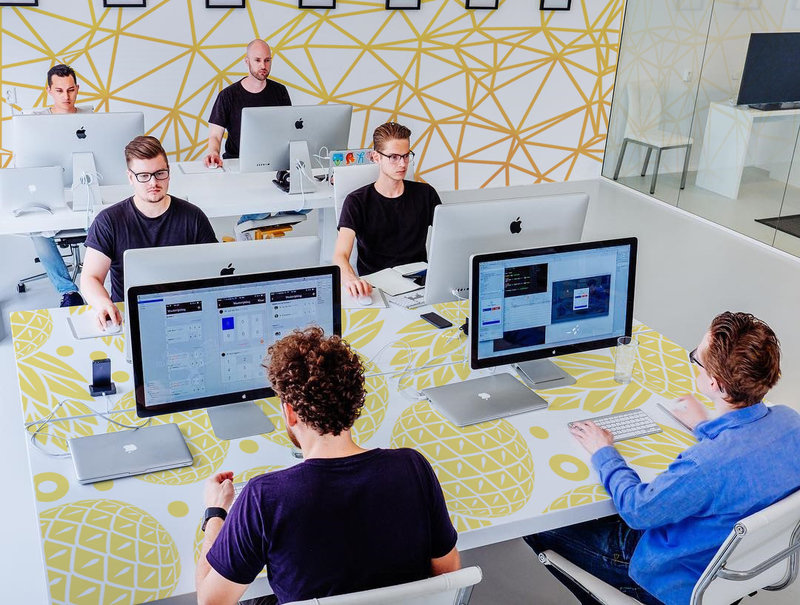Modern workplace in energetic colors by Pixers your business