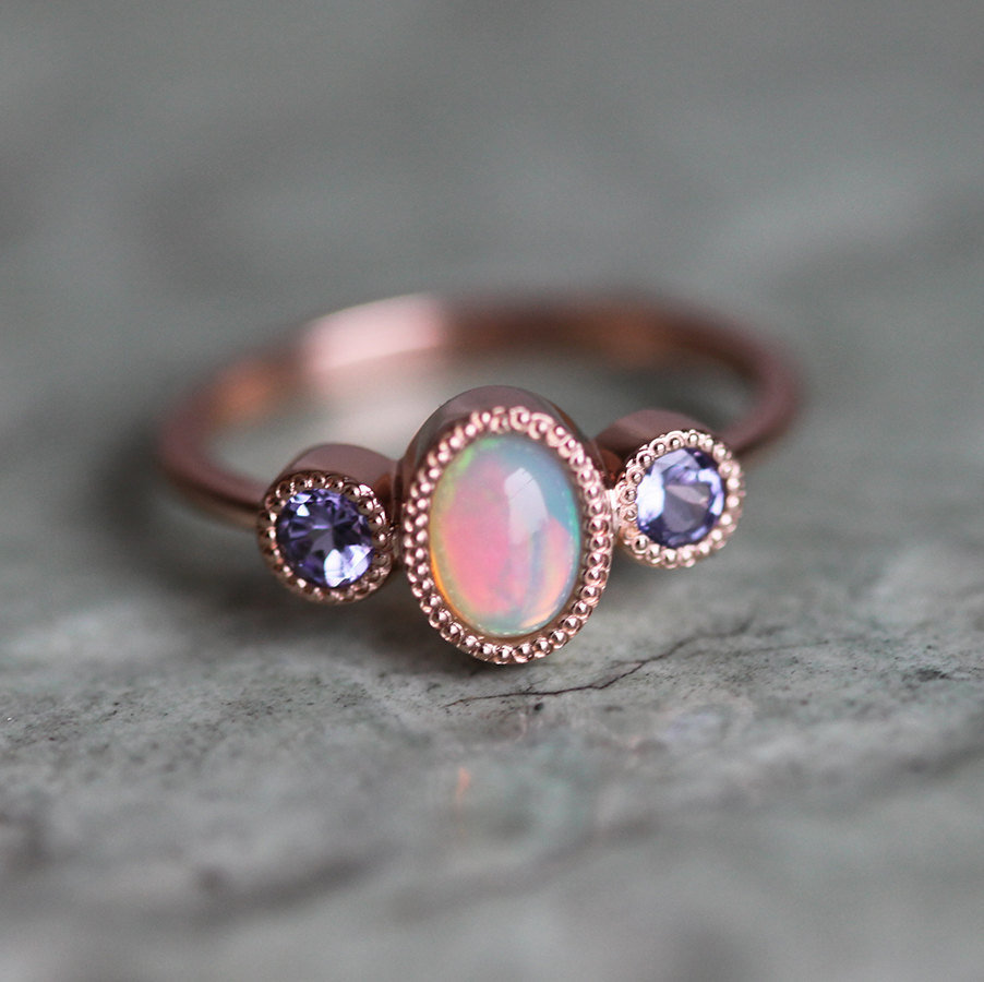 A hand-crafted Welo Opal ring with side Tanzanites by Minimal VS, 650€