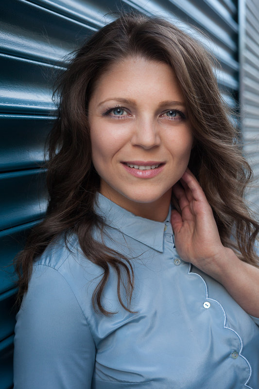Iliyana Stareva headshot blue background.jpg