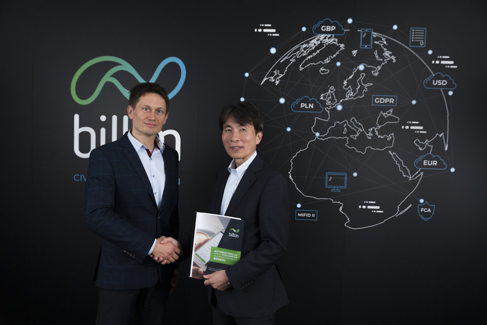 Billon's Marek Marczuk and Takumi Onodera, Deputy General Manager at MKI, in Billon's new office in Warsaw